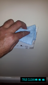 cleaning the plug with cloth